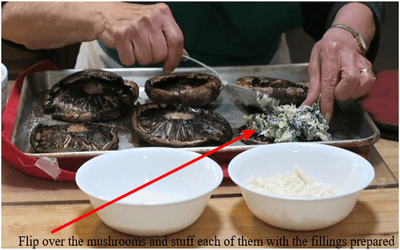 Flip over the mushrooms and stuff each of them with the fillings prepared