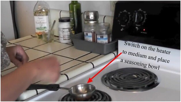 Switch on the heater to medium and place a seasoning bowl
